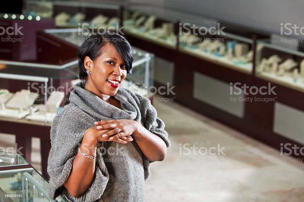 Woman shopping in jewelry store stock photo
