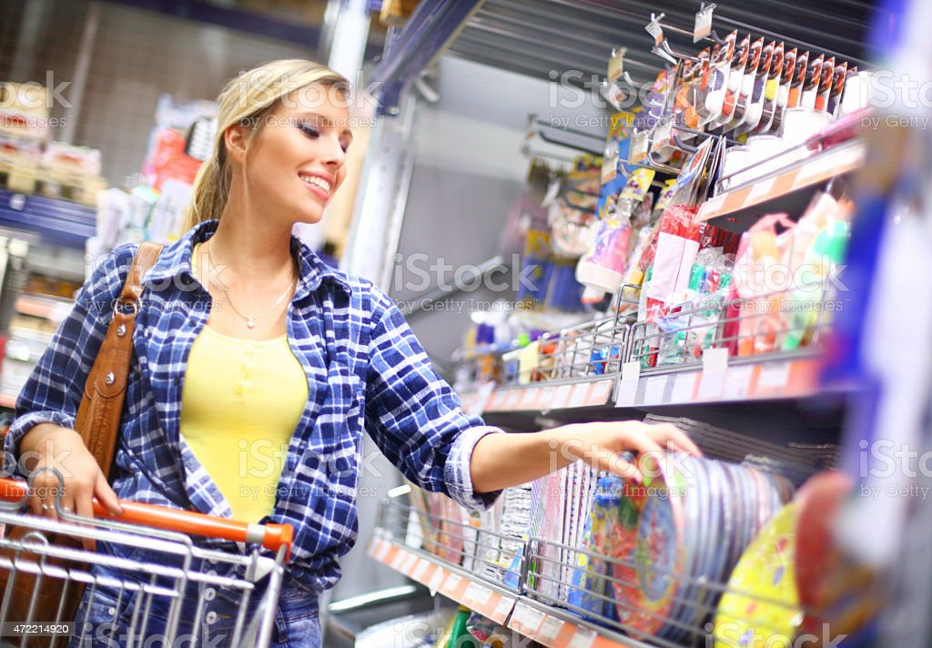Woman shopping in local supermarket. stock photo