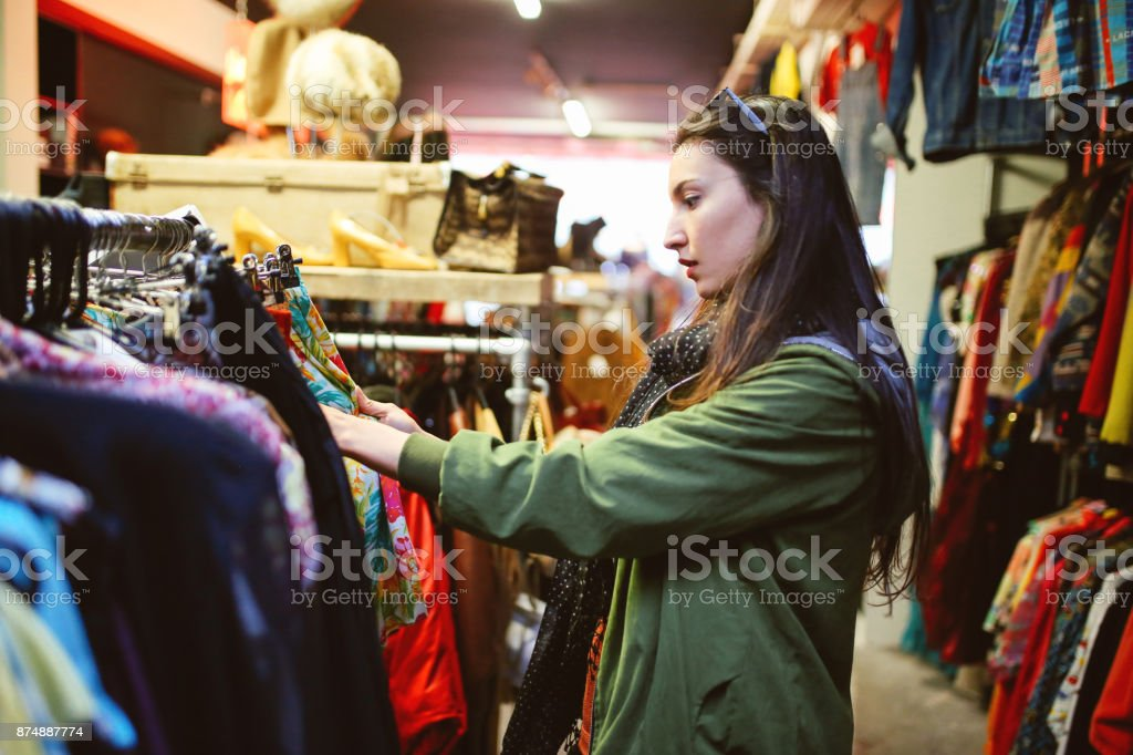 Woman shopping in London second hand marketplace stock photo