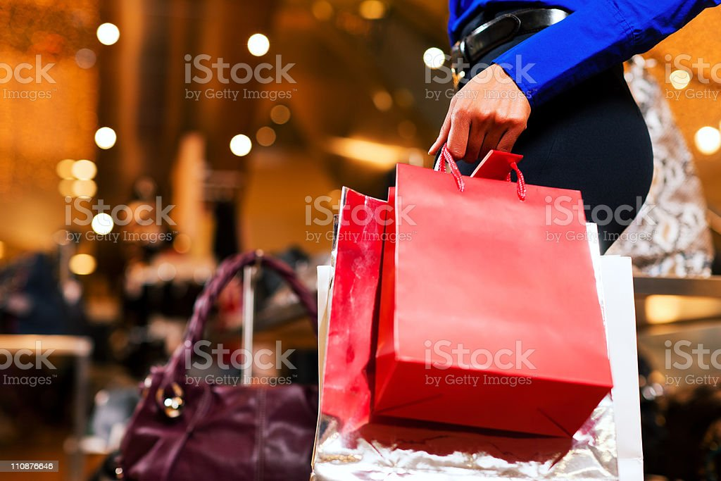 Woman shopping in Mall with bags royalty-free stock photo