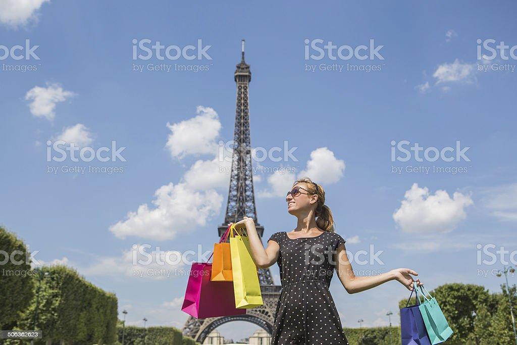 Woman shopping in paris, Eifel Tower royalty-free stock photo