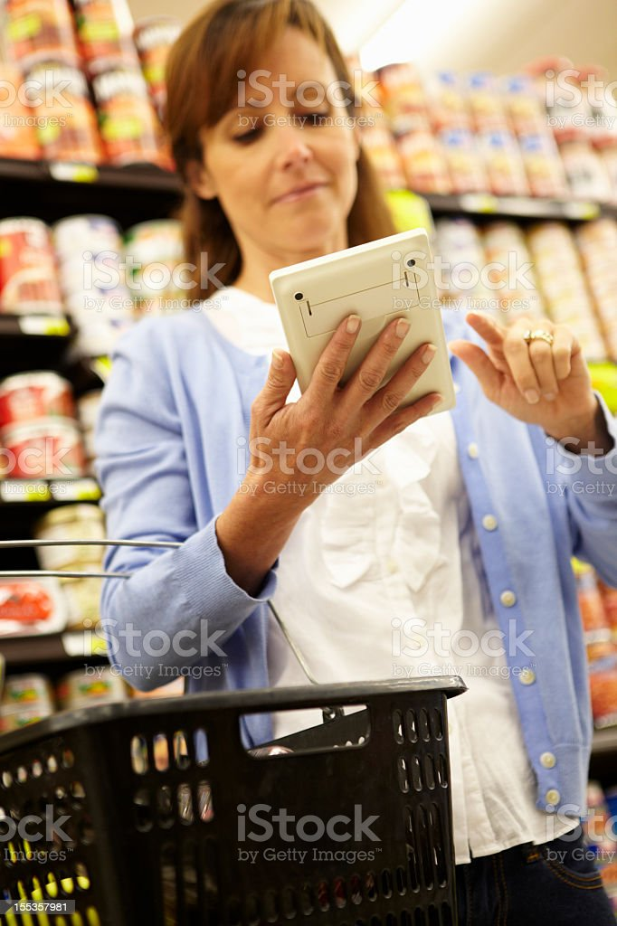Woman shopping in supermarket royalty-free stock photo