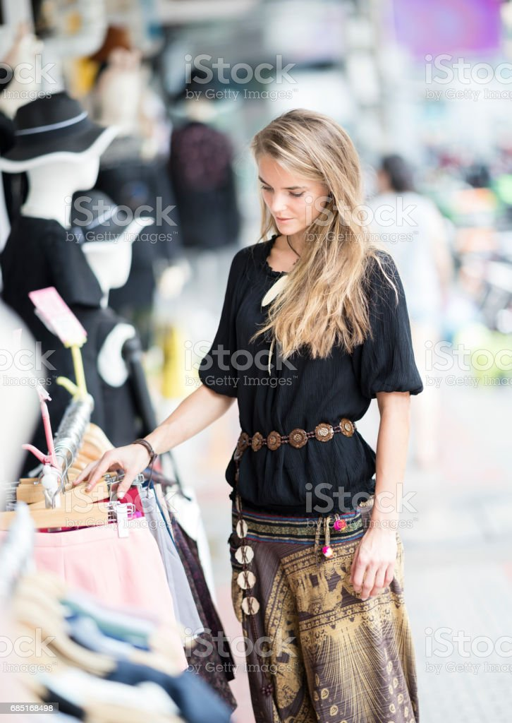 Woman shopping in the streets of Bangkok, Thailand royalty-free stock photo