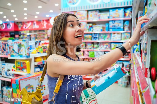 Asian woman customer shopping in toy store