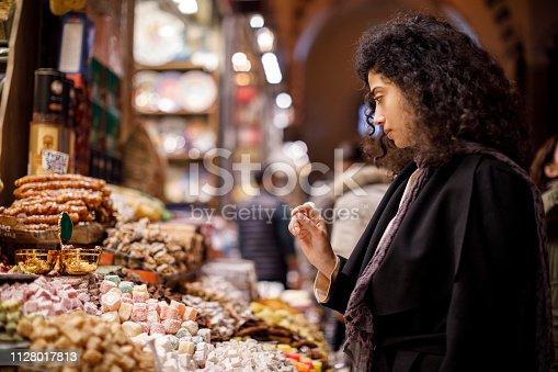 Woman shopping in turkish delight shop in Grand Bazaar, Istanbul, Turkey