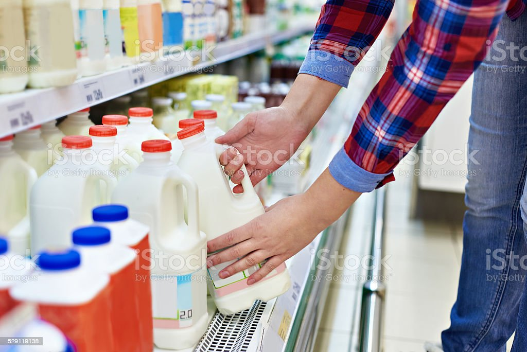 Woman shopping milk in store stock photo