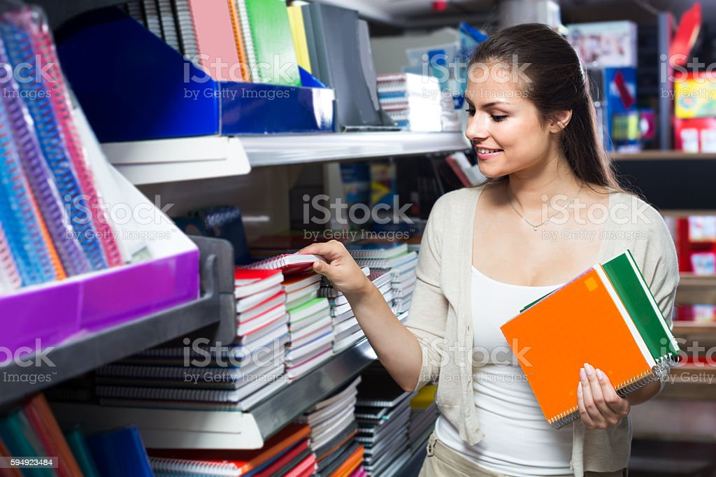 woman shopping notebooks stock photo