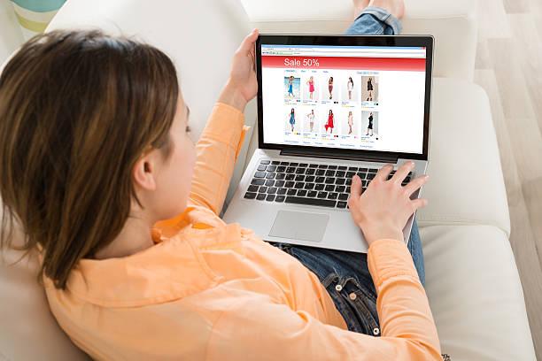 Woman Shopping On Laptop - Photo