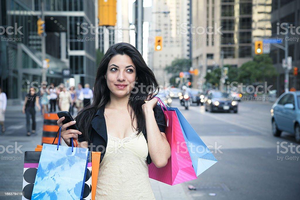 Woman shopping on the Toronto street royalty-free stock photo