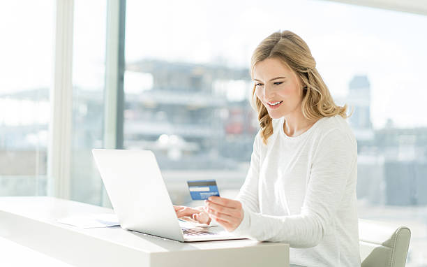 Woman shopping online at home stock photo