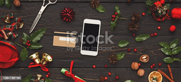 istock Woman shopping online for christmas on smartphone 1064195194