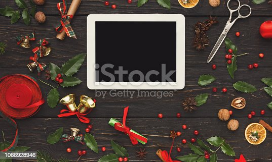 istock Woman shopping online for christmas on smartphone 1066928946