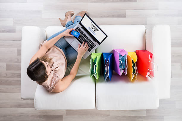 Woman Shopping Online On Laptop stock photo