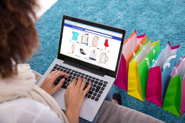 Woman Shopping Online On Laptop stock photo
