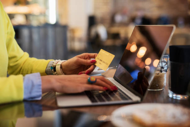 woman shopping online - spending money stock photos and pictures