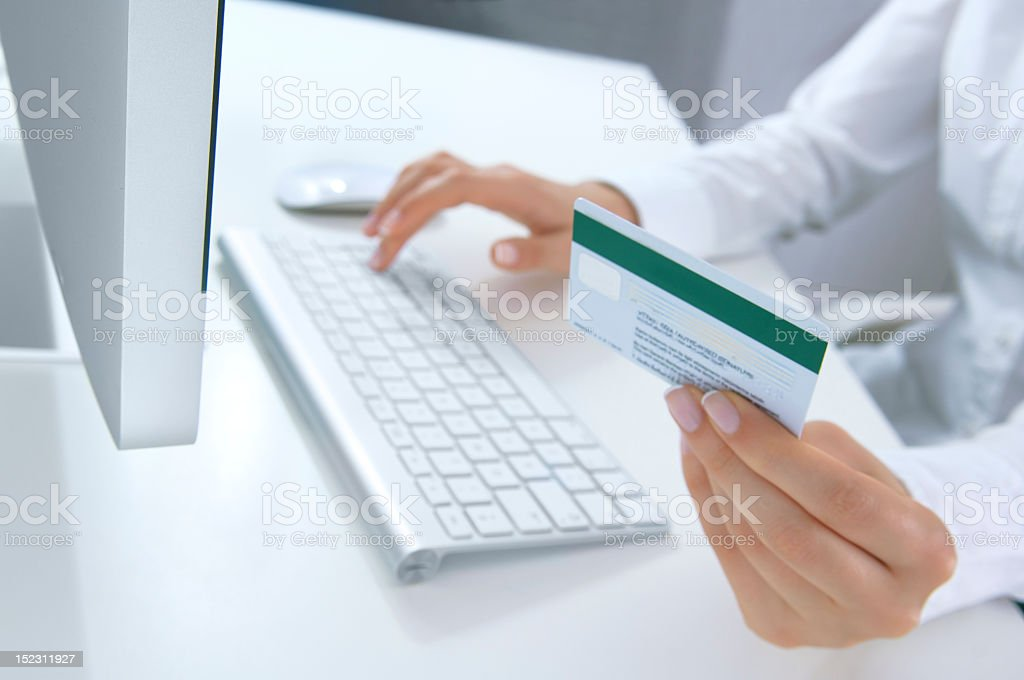 A woman shopping online using her MasterCard royalty-free stock photo