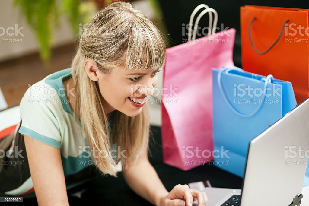 woman shopping online via Internet from home stock photo