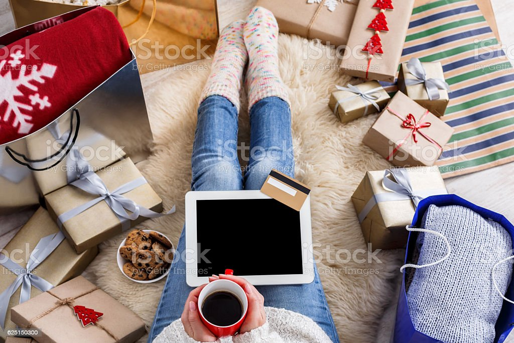Woman shopping online with a credit card stock photo