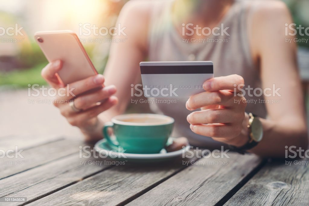Woman shopping online with credit card stock photo