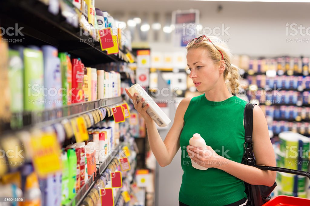 Woman shopping personal hygiene products at supermarket. stock photo