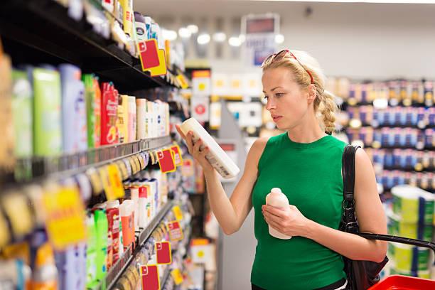 woman shopping personal hygiene products at supermarket. - bio lebensmittel stock-fotos und bilder