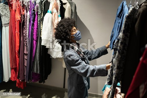 Woman shopping protecting herself wearing protective mask