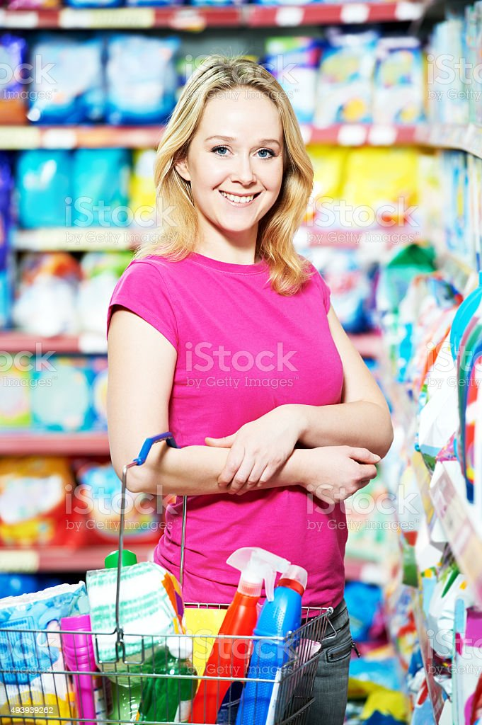 woman shopping toiletries and household cleaning supplies stock photo