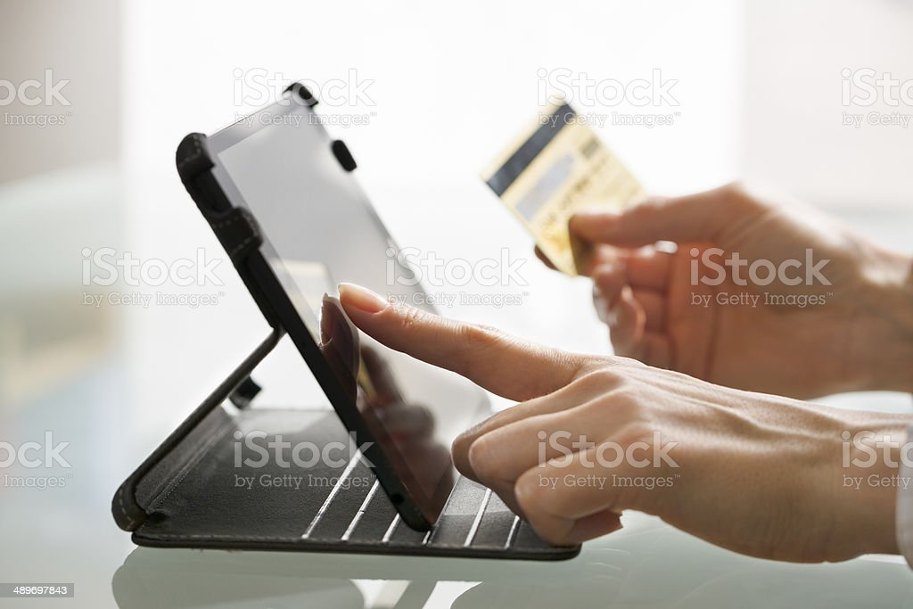 Woman shopping using tablet pc and credit card .indoor.close-up stock photo