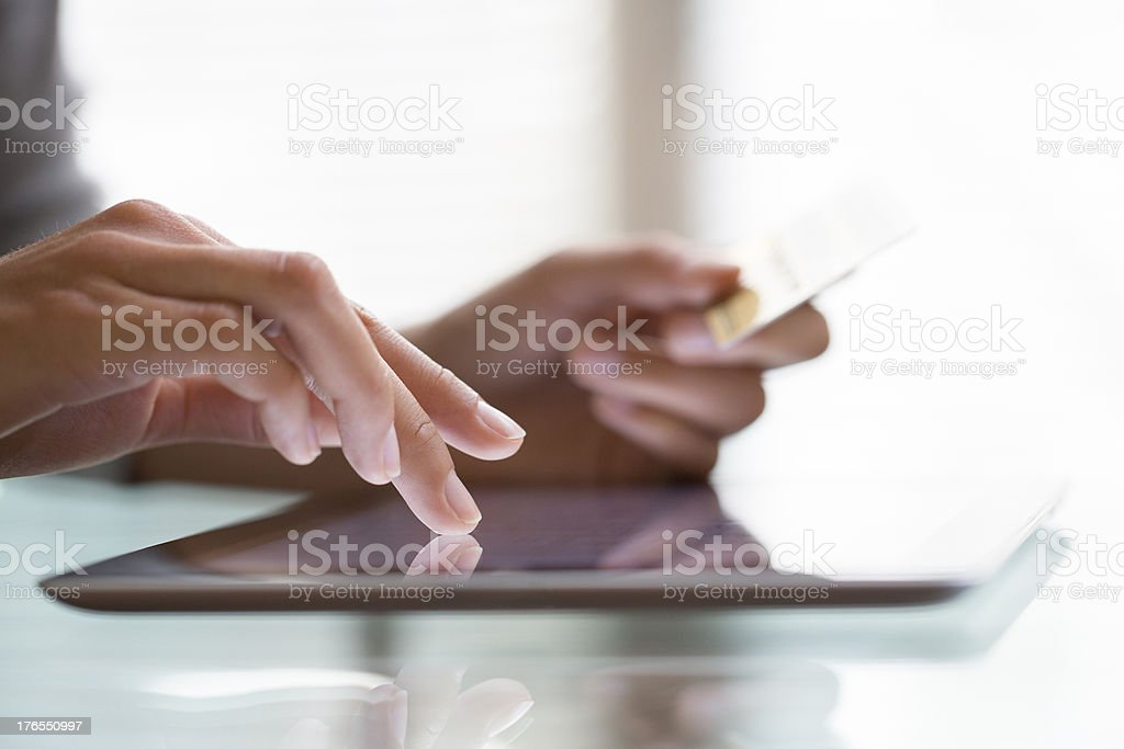 Woman shopping using tablet pc and credit card stock photo