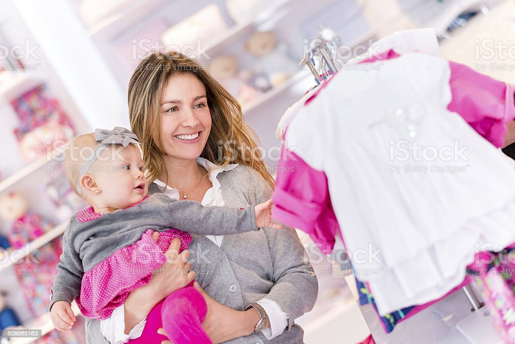Woman shopping with a baby stock photo
