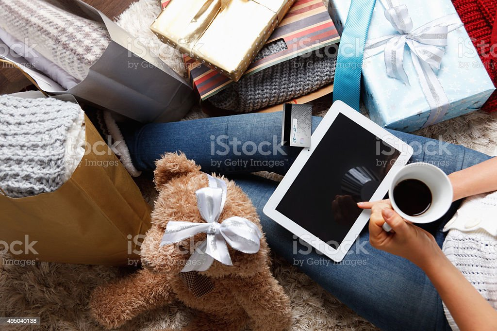 Woman shopping  with a credit card at home stock photo