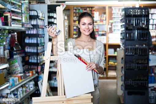 istock woman shopping wooden easel 628804714