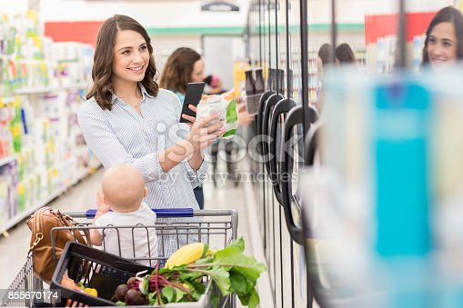istock Woman shops for frozen vegetables in a supermarket 855670174