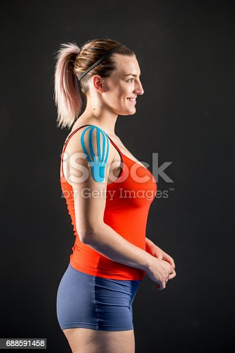 istock Woman Shoulder With Applied Kinesiology Tape 688591458