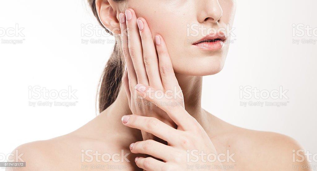 Woman shoulders lips hands fingers close-up portrait stock photo