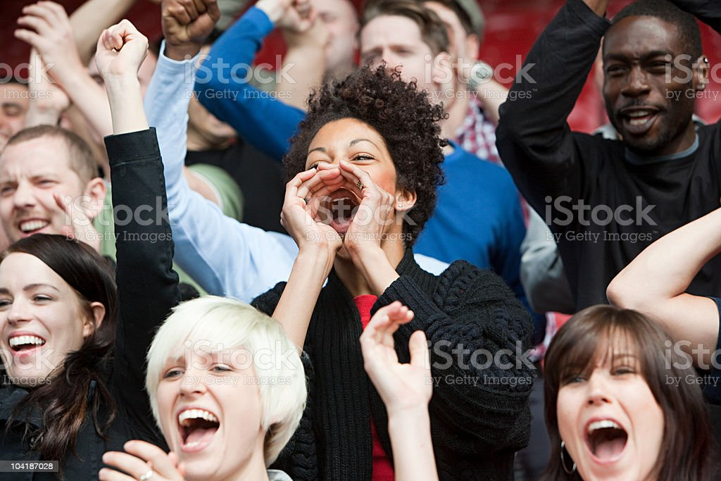 Woman shouting at football match stock photo