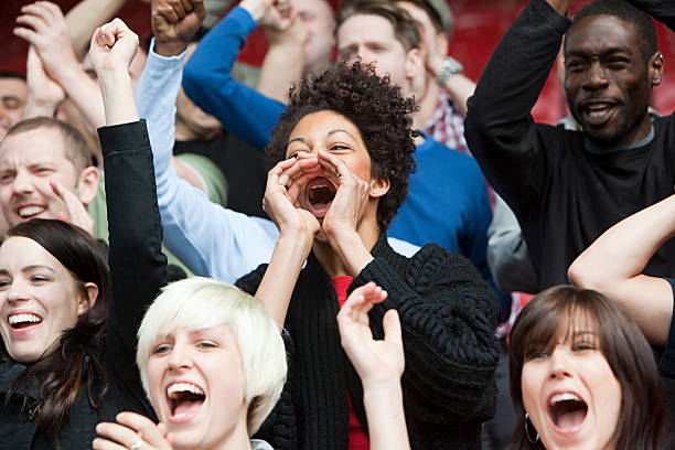 woman shouting at football match - fan enthusiast stock photos and pictures