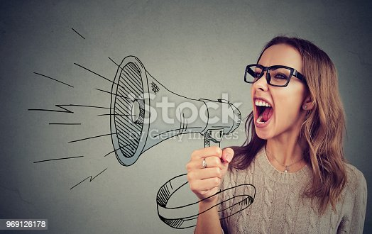 820421282istockphoto Woman shouting in megaphone 969126178