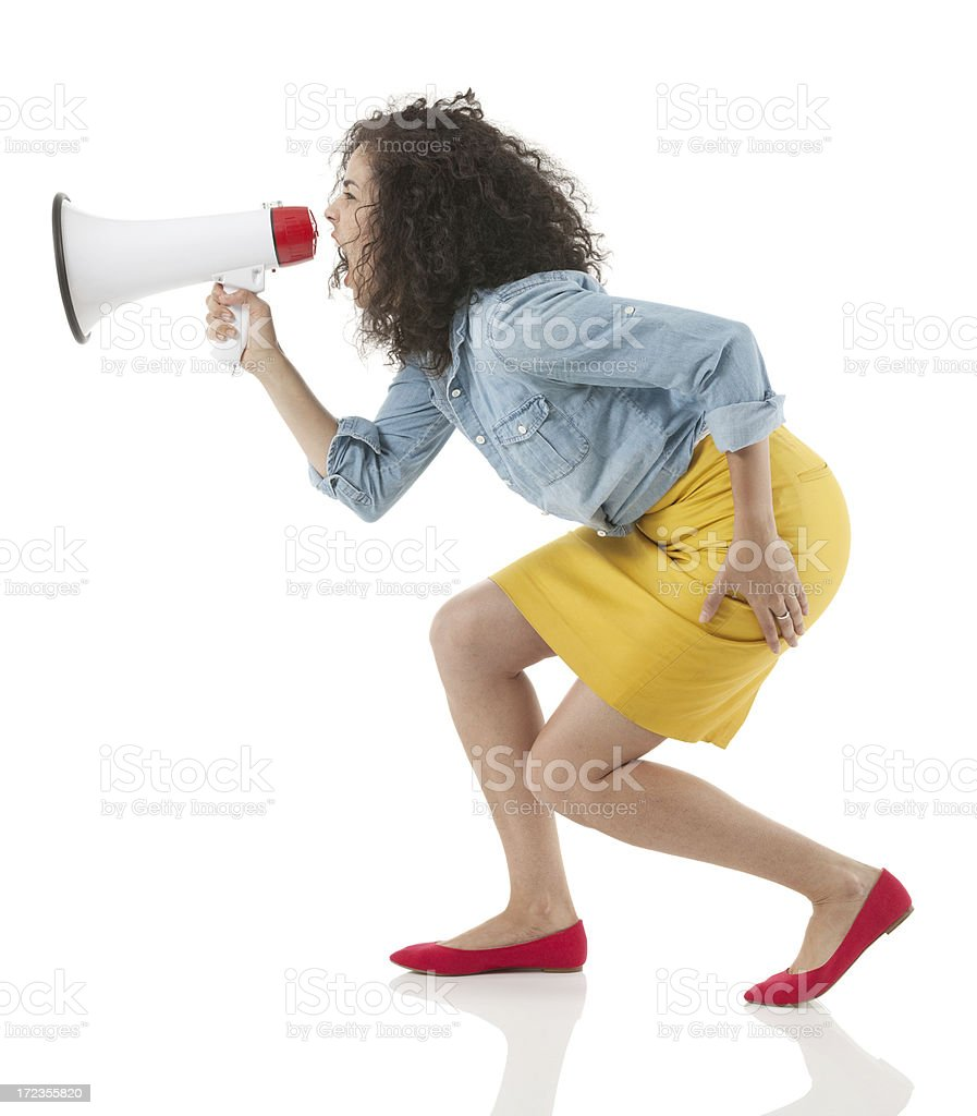 Woman shouting into a bullhorn royalty-free stock photo