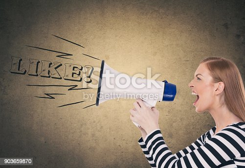903659714istockphoto Woman shouting on megaphone 903659870