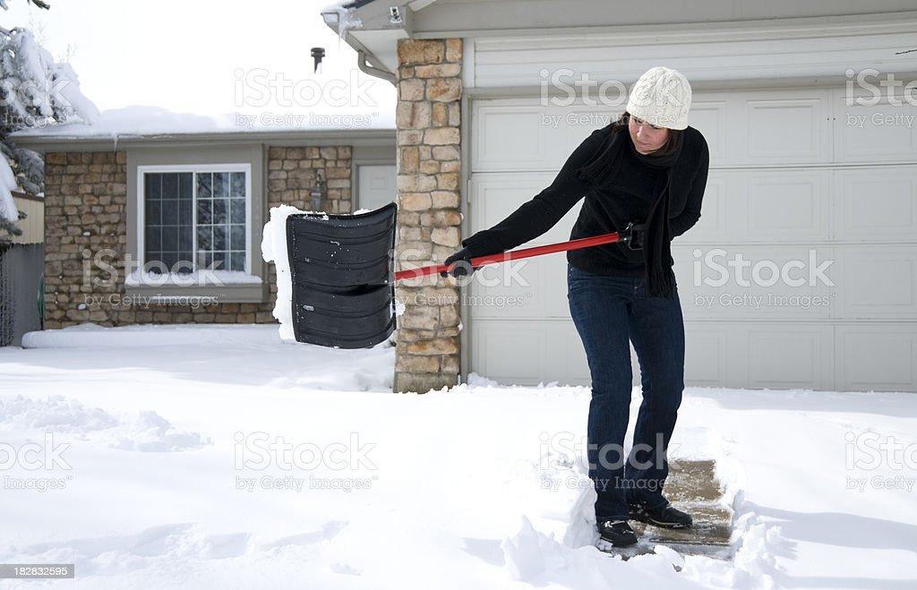 Woman Shoveling Driveway royalty-free stock photo