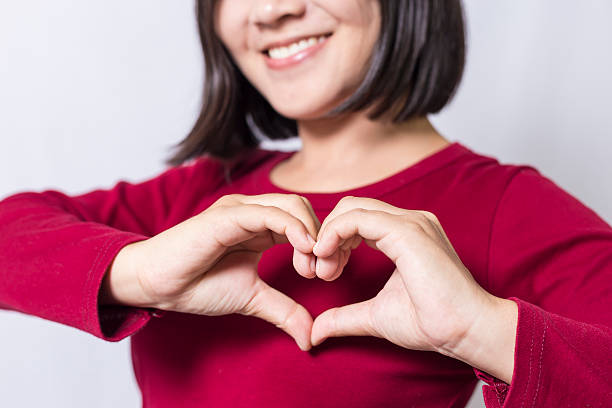 woman show heart hands - conceptual symbol stock pictures, royalty-free photos & images