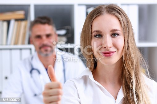526837216 istock photo Woman show OK or confirm with thumb up 846400572