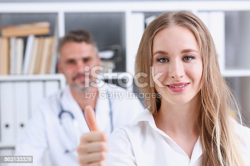 526837216 istock photo Woman show ok or confirm with thumb up 863133326
