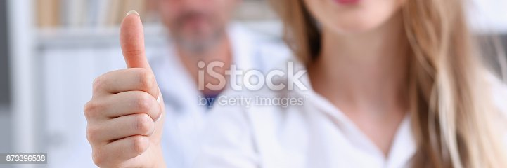 526837216 istock photo Woman show ok or confirm with thumb up 873396538