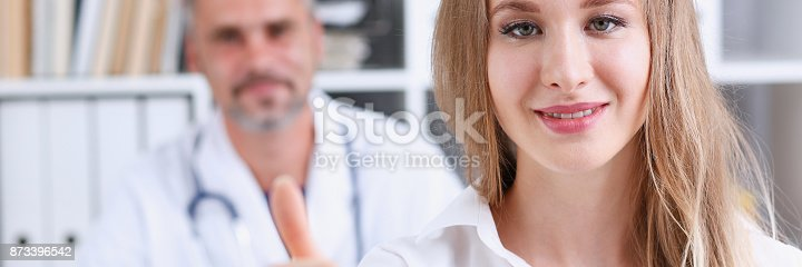 istock Woman show ok or confirm with thumb up 873396542