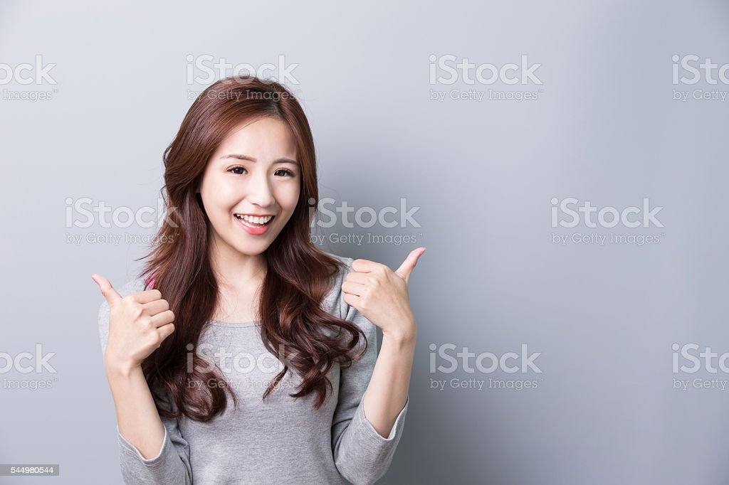 woman show thumb up stock photo