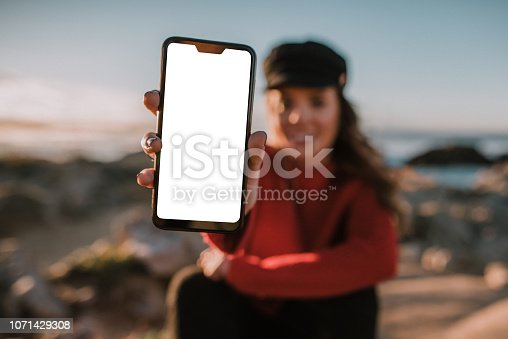 Woman showing a blank mobile phone screen