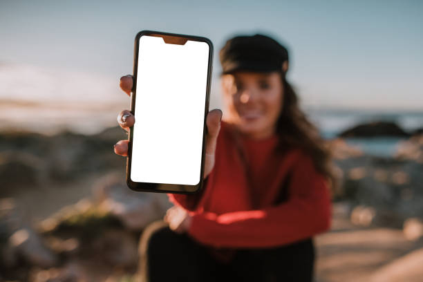 Woman showing a blank mobile phone screen stock photo