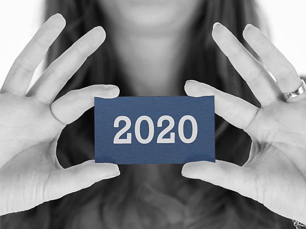 Woman showing a business card - 2020 - foto de acervo